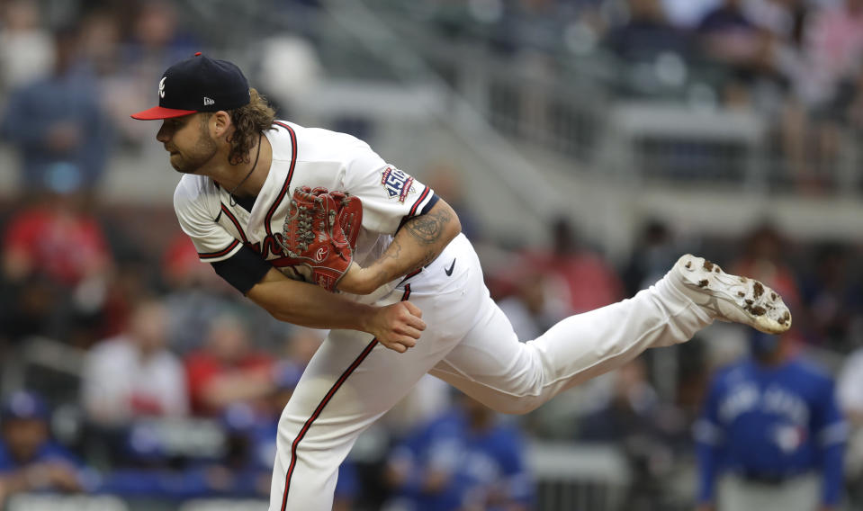 Atlanta Braves pitcher Bryse Wilson works against the Toronto Blue Jays in the first inning of a baseball game Tuesday, May 11, 2021, in Atlanta. (AP Photo/Ben Margot)