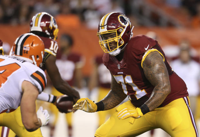 FILE - In this Aug. 13, 2015, file photo, Washington Redskins tackle Trent Williams (71) blocks Cleveland Browns linebacker Scott Solomon (54) during an NFL preseason football game in Cleveland. The San Francisco 49ers have acquired the seven-time Pro Bowl left tackle from the Redskins. Two people familiar with the deal said Saturday, April 25, 2020, the Niners will send a fifth-round pick in this years draft and a 2021 third-rounder to acquire Williams. (AP Photo/Ron Schwane, File)