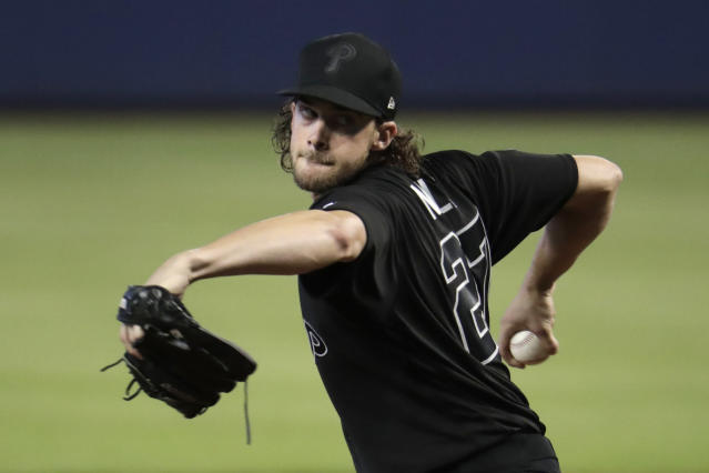 Philadelphia Phillies starting pitcher Aaron Nola winds up to deliver during the first inning of a baseball game against the Miami Marlins, Sunday, Aug. 25, 2019, in Miami. (AP Photo/Lynne Sladky)