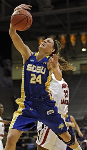 South Dakota State's Megan Waytashek (24) is fouled by South Carolina forward Elem Ibiam (33) while going to the basket during the first half of a first-round women's NCAA college basketball game on Saturday, March 23, 2013, in Boulder. (AP Photo/Brennan Linsley )