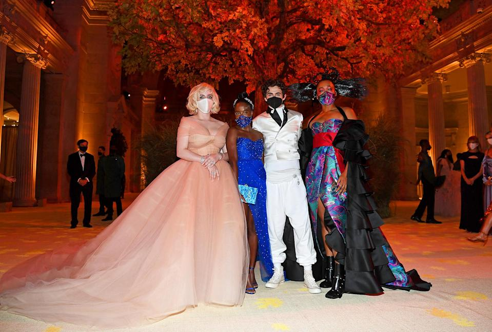 <p>were the co-hosts with the most, masked up for a stylish snap inside the museum. </p>