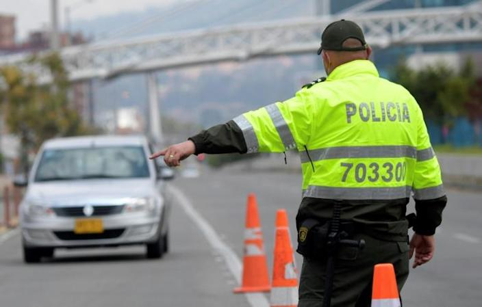 """Colombian police stop vehicles in Bogota on February 10, 2021 following a report that ELN rebels planned to attack the city in the """"next few days"""""""