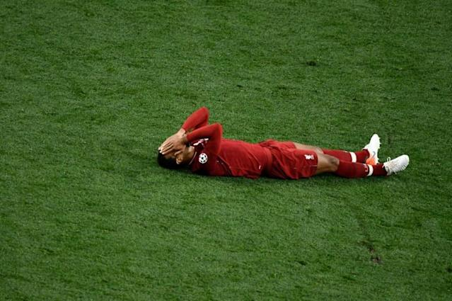 Virgil van Dijk was overcome as Liverpool won the Champions League in June (AFP Photo/OSCAR DEL POZO)