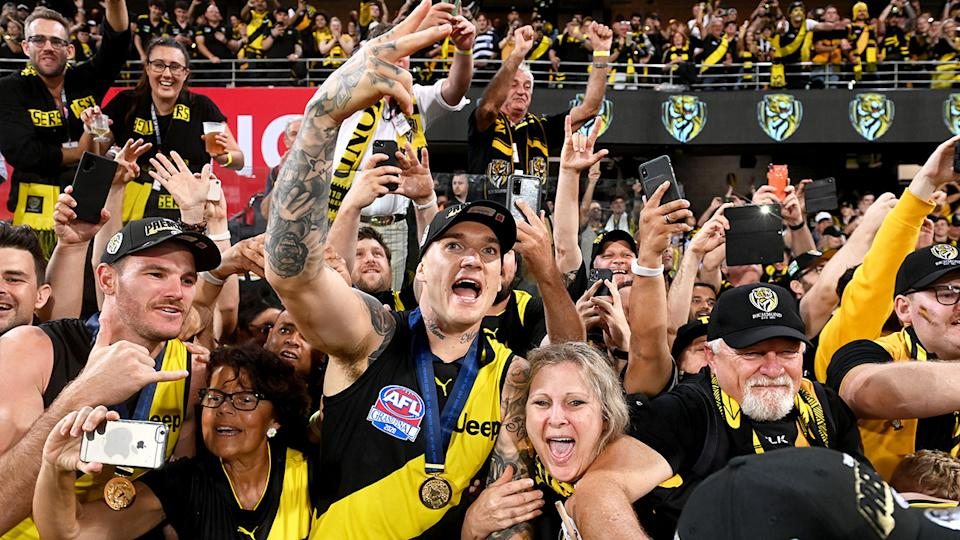 Dustin Martin is seen here celebrating a grand final win with fans.