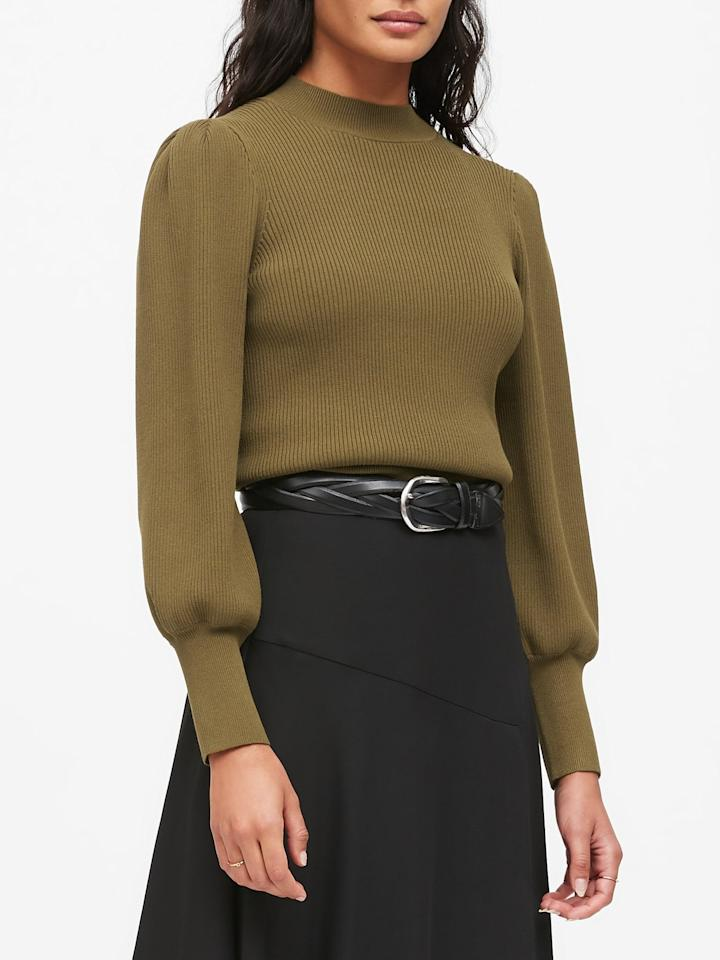 """<p>The olive shade of this <a href=""""https://www.popsugar.com/buy/Puff-Sleeve-Cropped-Sweater-498950?p_name=Puff-Sleeve%20Cropped%20Sweater&retailer=bananarepublic.gap.com&pid=498950&price=90&evar1=fab%3Aus&evar9=46726429&evar98=https%3A%2F%2Fwww.popsugar.com%2Ffashion%2Fphoto-gallery%2F46726429%2Fimage%2F46726436%2FPuff-Sleeve-Cropped-Sweater&list1=shopping%2Cbanana%20republic%2Cfall%20fashion%2Csweaters%2Cfall&prop13=api&pdata=1"""" rel=""""nofollow"""" data-shoppable-link=""""1"""" target=""""_blank"""" class=""""ga-track"""" data-ga-category=""""Related"""" data-ga-label=""""https://bananarepublic.gap.com/browse/product.do?pid=514200022&amp;cid=1071119&amp;pcid=5032&amp;vid=1&amp;grid=pds_9_29_1#pdp-page-content"""" data-ga-action=""""In-Line Links"""">Puff-Sleeve Cropped Sweater</a> ($90) is perfect for Fall.</p>"""