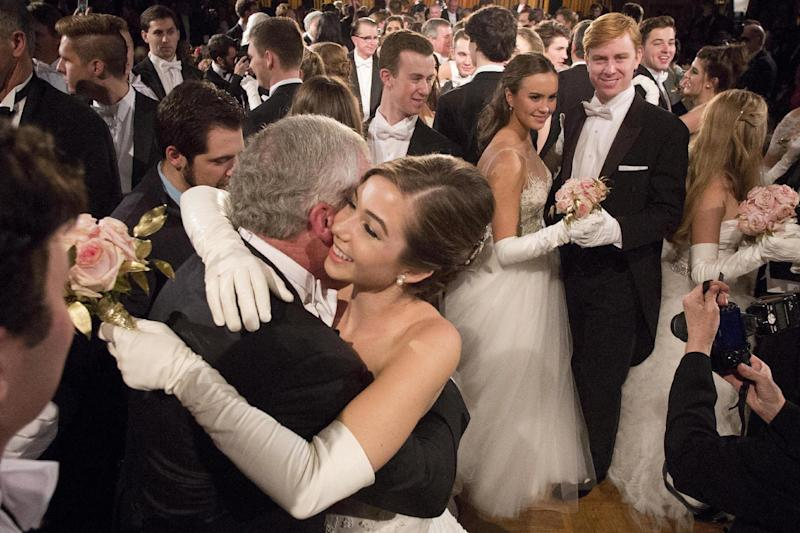 In this Thursday, Dec. 29, 2016 photo, Brindley Mize, of Houston, dances with her father, Christopher Mize, at the International Debutante Ball in New York. (AP Photo/Mark Lennihan)