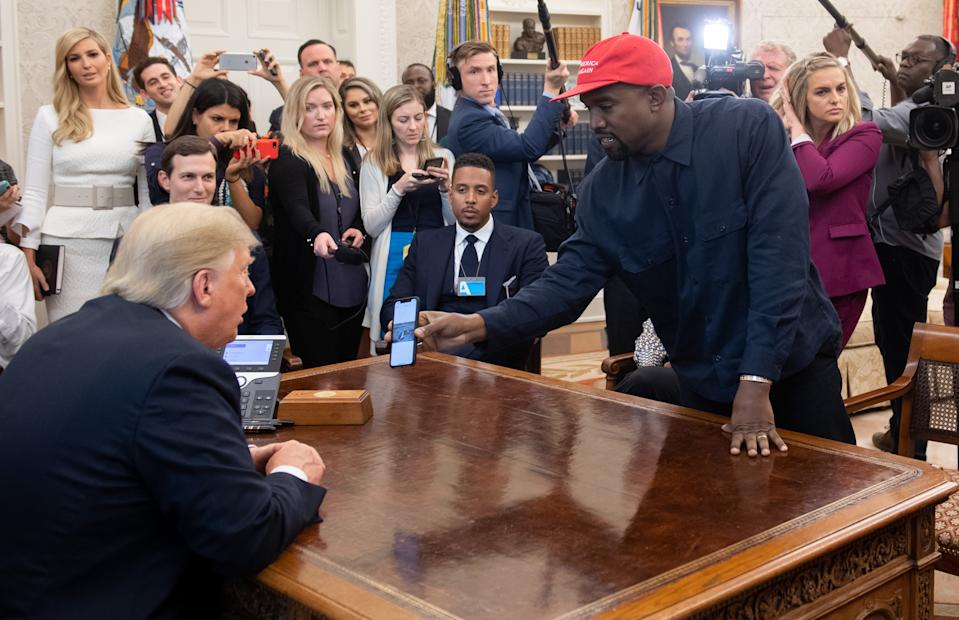 US President Donald Trump meets with rapper Kanye West (R) in the Oval Office of the White House in Washington, DC, on October 11, 2018. (Photo by SAUL LOEB / AFP)        (Photo credit should read SAUL LOEB/AFP/Getty Images)