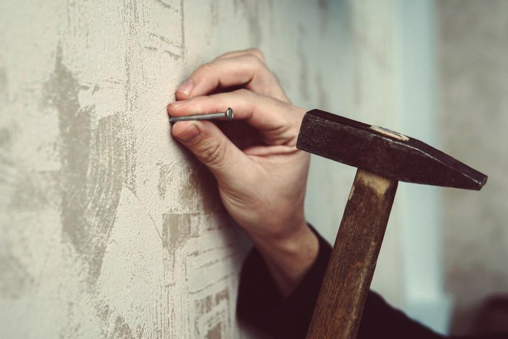 If you're living in a home with plaster walls, hanging pictures may be a trickier task than you'd imagined. If you're nailing directly into your walls willy-nilly, you could be causing cracks that can lead to the plaster falling away from the lath behind it over time. Instead, make sure you're using a stud finder and drywall screws to protect your walls and keep your art from falling off.