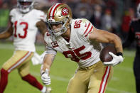San Francisco 49ers tight end George Kittle (85) runs after the catch for a touchdown against the Arizona Cardinals during the first half of an NFL football game, Thursday, Oct. 31, 2019, in Glendale, Ariz. (AP Photo/Rick Scuteri)