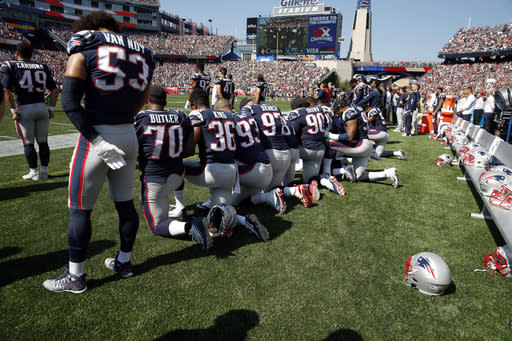 Several New England Patriots took a knee during the national anthem on Sunday. (AP)