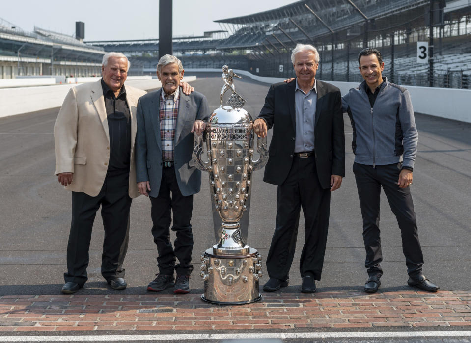 Winner of this year's Indianapolis 500 auto race, Helio Castroneves, right, gathered with other four-time winners, from left, A.J. Foyt (1961, 1964, 1967, 1977), Al Unser (1970, 1971, 1978, 1987) and Rick Mears (1979, 1984, 1988, 1991) at the Indianapolis Motor Speedway in Indianapolis, Tuesday, July 20, 2021. Castroneves won the race in 2001, 2002, 2009 and 2021. (AP Photo/Doug McSchooler)