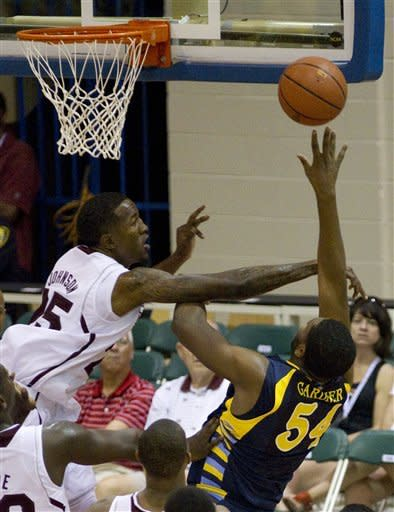 Mississippi State forward Roquez Johnson, left, fouls Marquette forward Davante Gardner (54) during the first half of an NCAA college basketball game Tuesday, Nov. 20, 2012, in Lahaina, Hawaii. (AP Photo/Eugene Tanner)