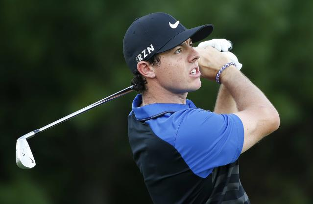 Rory McIlroy tees off on the third hole during the final round of the Deutsche Bank Championship golf tournament in Norton, Mass., Monday, Sept. 1, 2014. (AP Photo/Michael Dwyer)