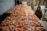 Xiang Xiuli's family said their orange business had doubled in size since the Qianqing road was built