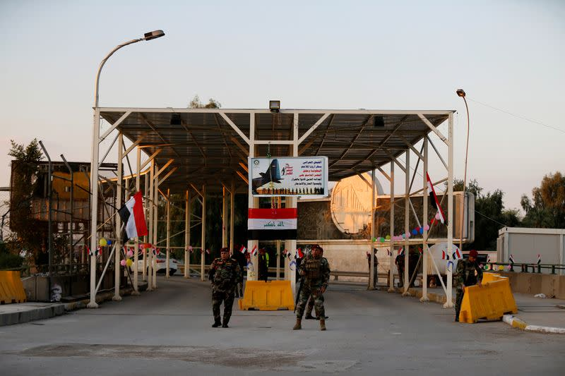 FILE PHOTO: Iraqi security forces gather at a checkpoint into the Green Zone in Baghdad