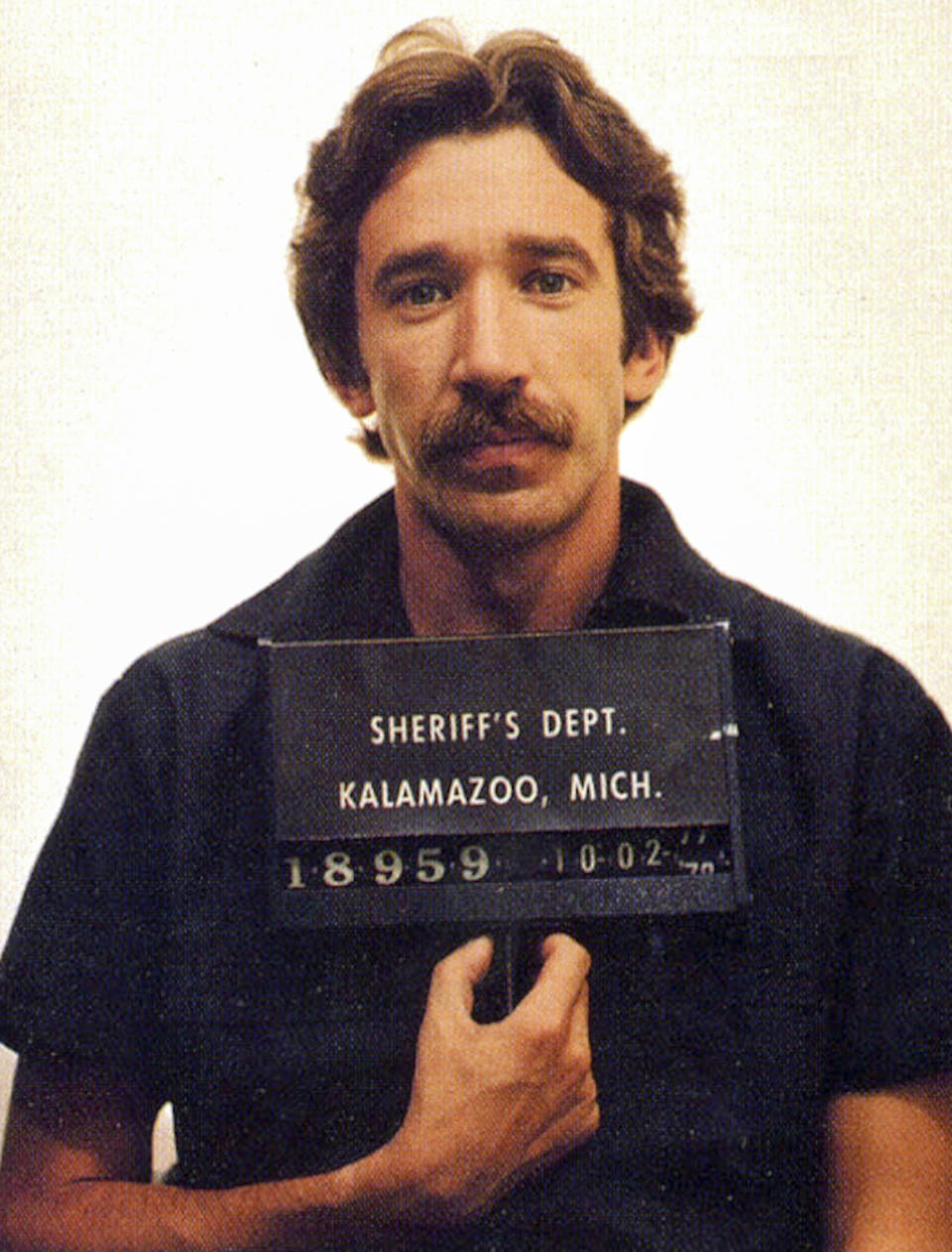 In this handout, American actor and comedian Tim Allen in a mug shot following his arrest for cocaine possession, Kalamazoo, Michigan, US, 2nd October 1978. (Photo by Kypros/Getty Images)