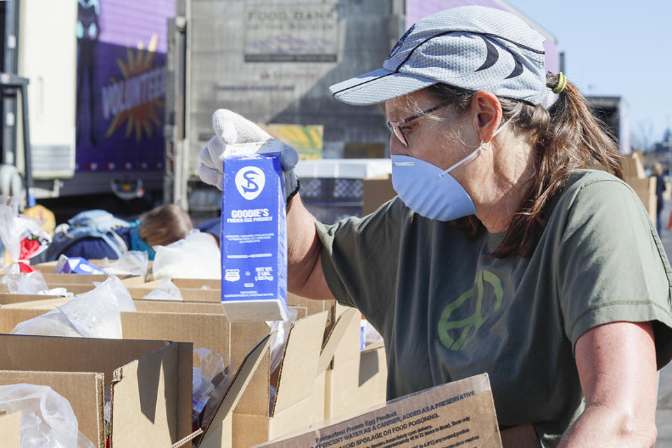 Food Bank volunteers have also had to change the way they give food to those in need to not only protect themselves, but also the people they serve (Photo: Erin Pulling)