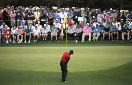 Tiger Woods hits to the fourth green during the final round for the Masters golf tournament, Sunday, April 14, 2019, in Augusta, Ga. (AP Photo/Charlie Riedel)