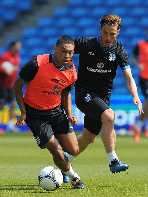 Englands's Alex Oxlade-Chamberlain (L) and Scott Parker vie for the ball a training session at The Etihad stadium in Manchester, north-west England on May 24, 2012 ahead of their international friendly football match against Norway in Oslo on Saturday May 26. AFP PHOTO/ANDREW YATES. NOT FOR MARKETING OR ADVERTISING USE/RESTRICTED TO EDITORIAL USEANDREW YATES/AFP/GettyImages