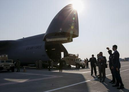 The first plane from United States with non-lethal aid including ten Humvee vehicles is seen at Borispol airport near Kiev