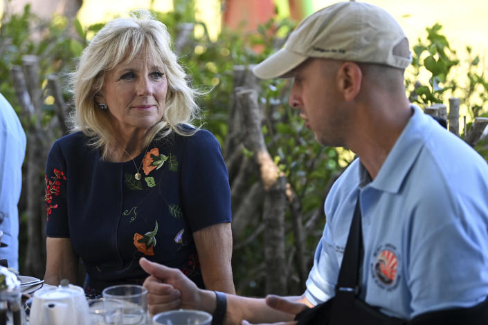 US First Lady Jill Biden smiles as she meets military surfers in Newlyn, Cornwall, England, on the sidelines of the G7 summit, Saturday June 12, 2021. US First Lady Jill Biden met with veterans, first responders and family members of Bude Surf Veterans, a Cornwall-based volunteer organization that provides social support and surfing excursions for veterans, first responders and their families. (Daniel Leal-Olivas/Pool via AP)