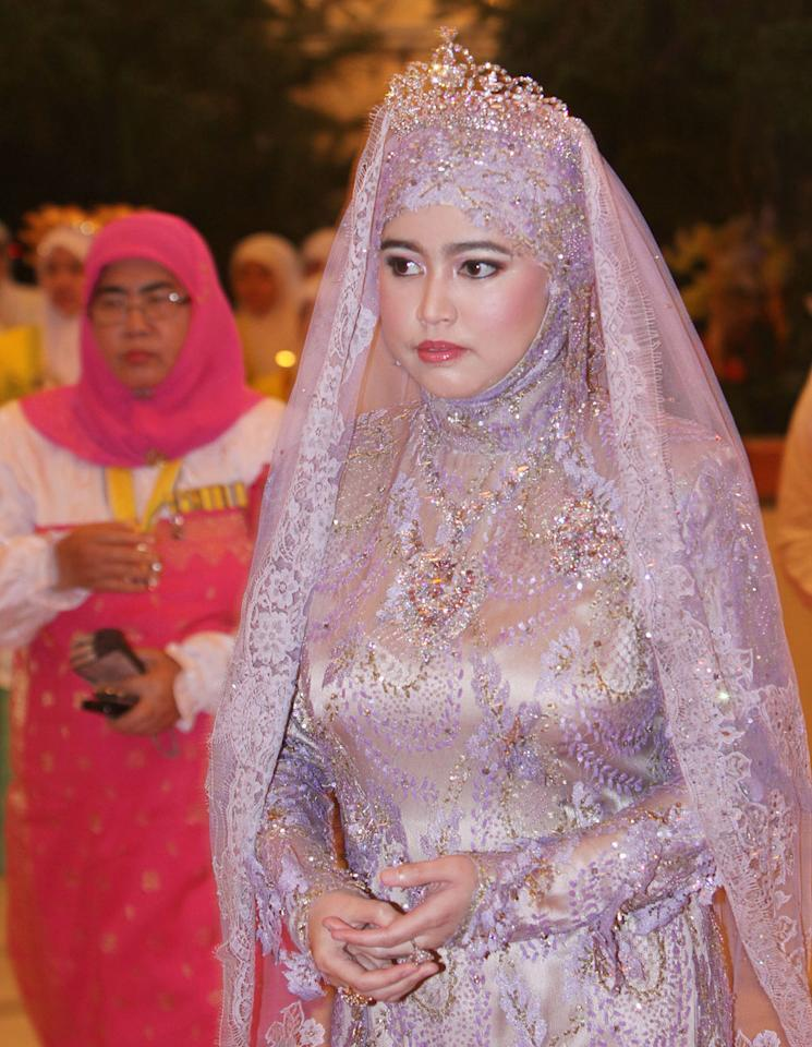 """<div class=""""caption-credit""""> Photo by: Wenn.com</div><div class=""""caption-title""""></div>In this photo, Princess Hajah Hafizah Sururul Bolkiah attends a ceremony ahead of the wedding. In Muslim countries like Brunei, """"A wedding is a reflection of your family, culture and values,"""" says Saukok Tiampo, founder of the <a rel=""""nofollow"""" target="""""""" href=""""http://www.57grand.com/"""">57Grand</a> line of bridal wear and editor-in-chief of <a rel=""""nofollow"""" target="""""""" href=""""http://www.revel-blog.com/"""">Revel-Blog.com</a>. """"Its different from an American wedding, which reflects more on yourselves and your love for each other."""" The princess is the fifth child of the Sultan and his wife, Queen Saleha. <br>"""