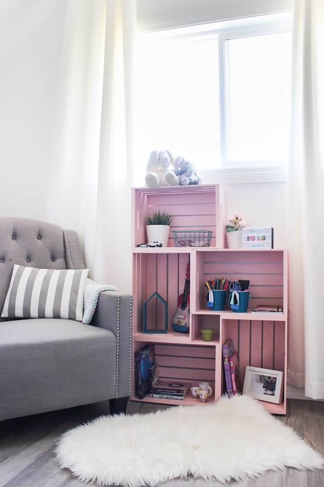 """<p>Fuse wood crates together to make the perfect standing bookshelf for a child's room. Spray paint each crate your color of choice.  </p><p><strong>Get the tutorial at <a href=""""https://lovecreatecelebrate.com/diy-crate-bookshelf/"""" target=""""_blank"""">Love Create Celebrate</a>. </strong></p><p><a class=""""body-btn-link"""" href=""""https://www.amazon.com/Wald-Imports-Whitewash-Decorative-Storage/dp/B00N0S0QL2?tag=syn-yahoo-20&ascsubtag=%5Bartid%7C10050.g.30770089%5Bsrc%7Cyahoo-us"""" target=""""_blank"""">SHOP WOOD CRATES</a></p>"""