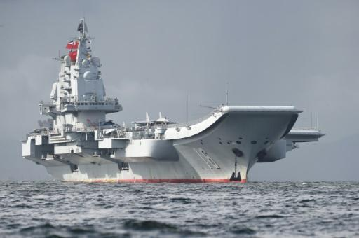 <p>China's aircraft carrier sails by Taiwan as tensions grow</p>