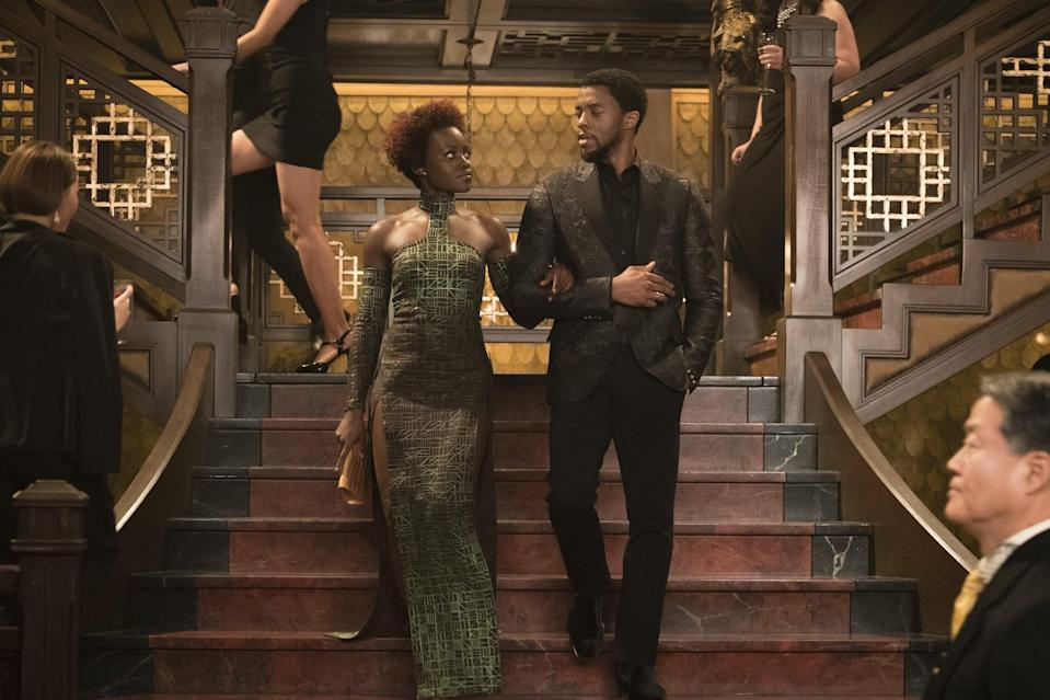 """<p><strong>For T'Challa:</strong> There are some adult-size <a class=""""link rapid-noclick-resp"""" href=""""https://www.popsugar.com/latest/Black-Panther"""" rel=""""nofollow noopener"""" target=""""_blank"""" data-ylk=""""slk:Black Panther"""">Black Panther</a> costumes floating around, but you can also <a class=""""link rapid-noclick-resp"""" href=""""https://www.popsugar.com/DIY"""" rel=""""nofollow noopener"""" target=""""_blank"""" data-ylk=""""slk:DIY"""">DIY</a> by wearing a long-sleeved black shirt and black pants and adding the silver designs around the neckline and forearms yourself. Tell everyone you're already preparing for <a href=""""https://www.popsugar.com/entertainment/Black-Panther-Sequel-Details-44655839"""" class=""""link rapid-noclick-resp"""" rel=""""nofollow noopener"""" target=""""_blank"""" data-ylk=""""slk:Black Panther 2""""><strong>Black Panther 2</strong></a>.</p> <p><strong>For Nakia:</strong> Nakia is always in shades of green, so go with an olive-toned dress that has a high neck, cutouts, and long sleeves. Also bring along a gold clutch full of secret spy trinkets from Wakanda. With the sequel on the way, this costume couldn't be more perfect.</p>"""