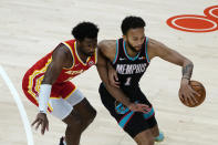 Memphis Grizzlies forward Kyle Anderson (1) works against Atlanta Hawks forward Solomon Hill (18) in the first half of an NBA basketball game Wednesday, April 7, 2021, in Atlanta. (AP Photo/John Bazemore)