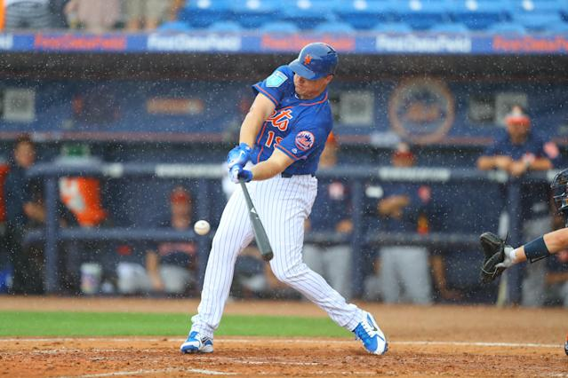 <p>New York Mets slugger Jay Bruce (19) connects with a pitch as the rain gets harder in the third inning of a baseball game against the Houston Astros at First Data Field in Port St. Lucie, Fla., Feb. 27, 2018. (Photo: Gordon Donovan/Yahoo News) </p>
