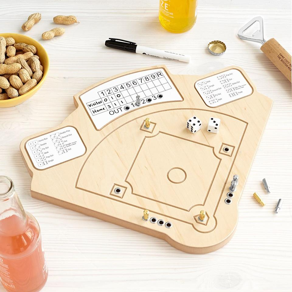 """<p>Since live sports aren't on right now, he'll really love this <a href=""""https://www.popsugar.com/buy/Baseball-Game-579528?p_name=Baseball%20Game&retailer=uncommongoods.com&pid=579528&price=56&evar1=savvy%3Aus&evar9=44104053&evar98=https%3A%2F%2Fwww.popsugar.com%2Fsmart-living%2Fphoto-gallery%2F44104053%2Fimage%2F47527860%2FBaseball-Game&list1=shopping%2Cgifts%2Choliday%2Cgift%20guide%2Cgifts%20for%20men%2Cshoppable&prop13=mobile&pdata=1"""" rel=""""nofollow"""" data-shoppable-link=""""1"""" target=""""_blank"""" class=""""ga-track"""" data-ga-category=""""Related"""" data-ga-label=""""https://www.uncommongoods.com/product/baseball-game"""" data-ga-action=""""In-Line Links"""">Baseball Game</a> ($56).</p>"""