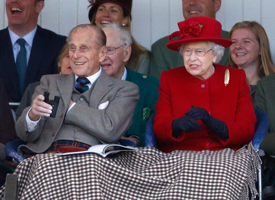 """<p>After nearly 68 years of marriage, the queen's former private secretary Lord Charteris <a href=""""http://www.mirror.co.uk/news/uk-news/prince-philip-quotes-the-queen-and-her-husband-1446365"""" rel=""""nofollow noopener"""" target=""""_blank"""" data-ylk=""""slk:reveals one key"""" class=""""link rapid-noclick-resp"""">reveals one key</a> to the pair's lasting love: """"Prince Philip is the only man in the world who treats the Queen simply as another human being. I think she values that. And it is not unknown for the Queen to tell the Duke to shut up."""" Here, the royal couple enjoy the Highland Games in Braemar, Scotland, on September 5, where they laughed and cheered loudly at the event. </p>"""