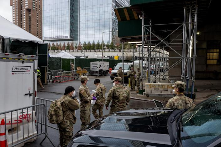 Members of the National Guard at the temporary morgue set up near the medical examiner's office in New York, on Saturday, April 4, 2020. (Jonah Markowitz/The New York Times)