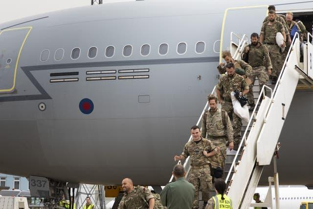 UK military personnel arrive home from Afghanistan