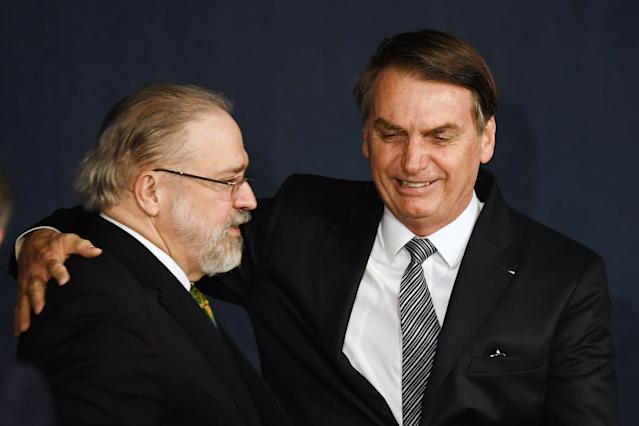 Brazilian President Jair Bolsonaro (R) greets Brazil's Attorney General Augusto Aras during his inauguration ceremony in Brasilia, on October 2, 2019. (Photo by EVARISTO SA / AFP) (Photo by EVARISTO SA/AFP via Getty Images)