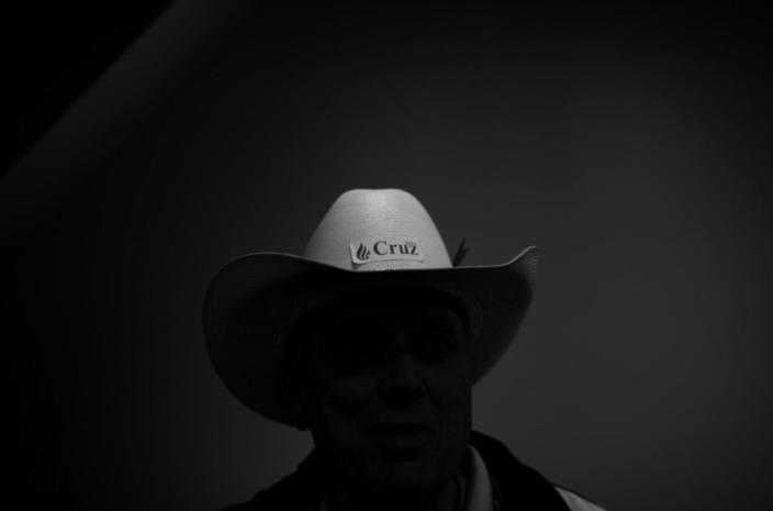 <p>A Ted Cruz supporter is seen in the shadows. (Photo: Khue Bui for Yahoo News)</p>