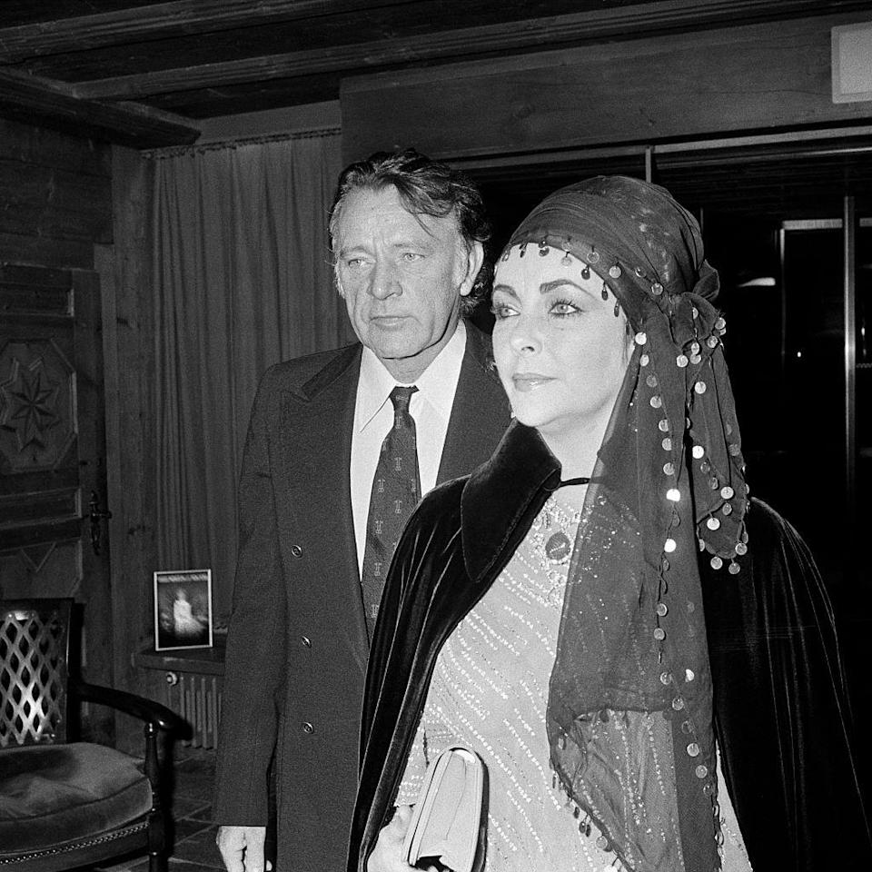 <p>Richard Burton kept his ensemble simple when celebrating the holidays in Gstaad, Switzerland with Elizabeth Taylor with a black suit and printed dark tie.</p>