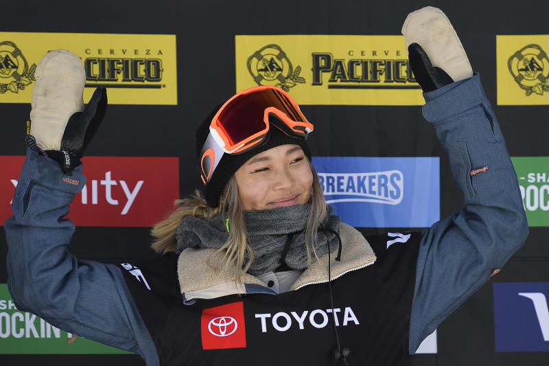 Gold medalist Chloe Kim of the United States celebrates after winning the women's snowboard halfpipe final at the freestyle ski and snowboard world championships, Friday, Feb. 8, 2019, in Park City, Utah. (AP Photo/Alex Goodlett)
