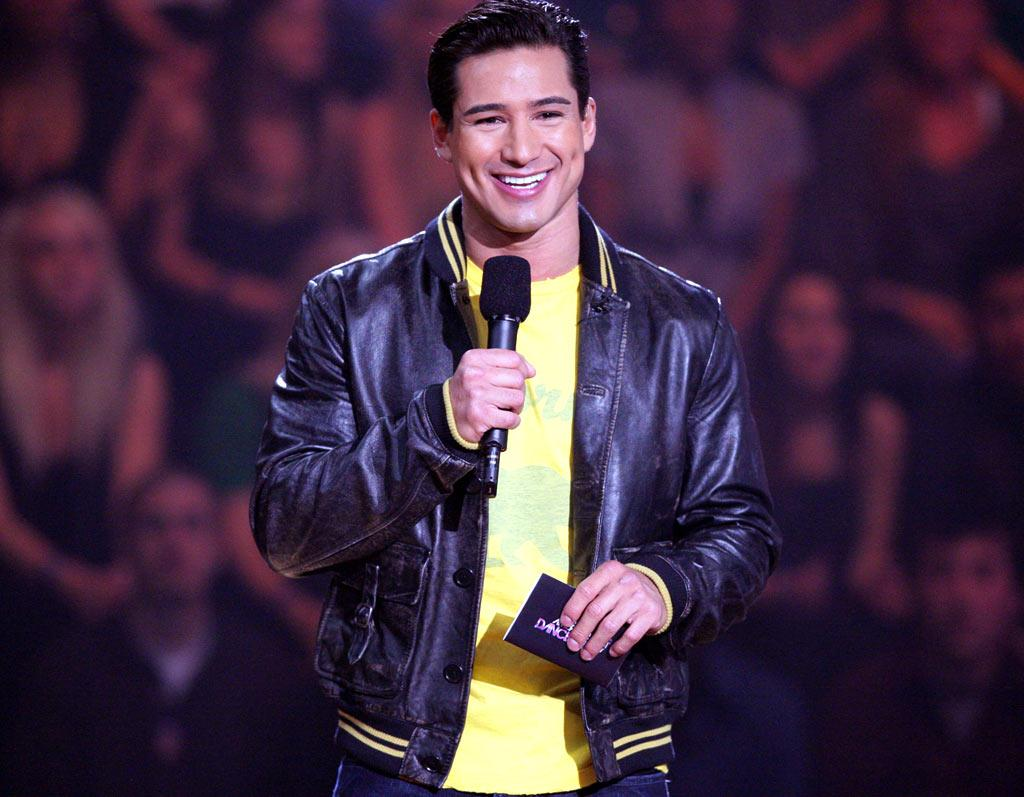 """The man, the myth, the legend... <a href=""""/mario-lopez/contributor/47338"""">Mario Lopez</a> (best known as Bayside Tigers stud A.C. Slater) flashes his trademark dimples for another exciting evening behind the mic."""