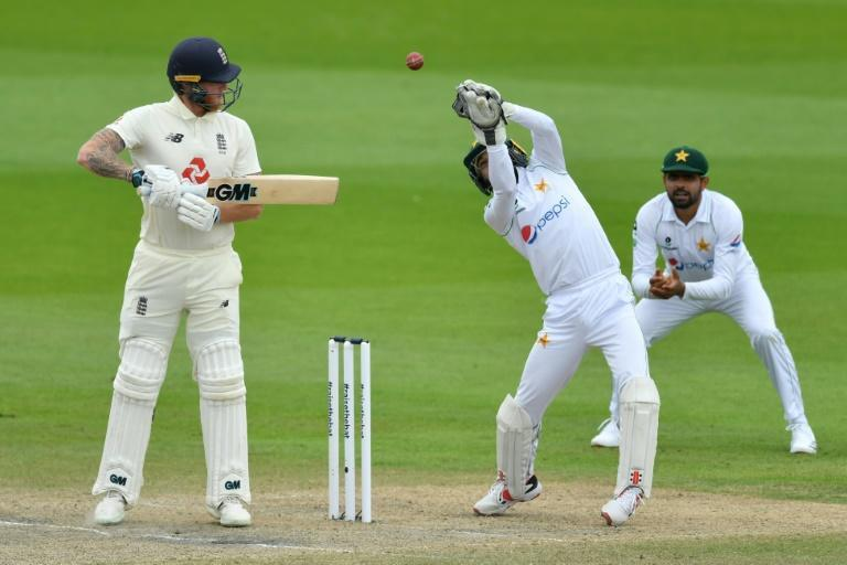 Well held - Pakistan wicketkeeper Mohammad Rizwan takes a brilliant catch to dismiss England's Ben Stokes off Yasir Shah in the first Test at Old Trafford