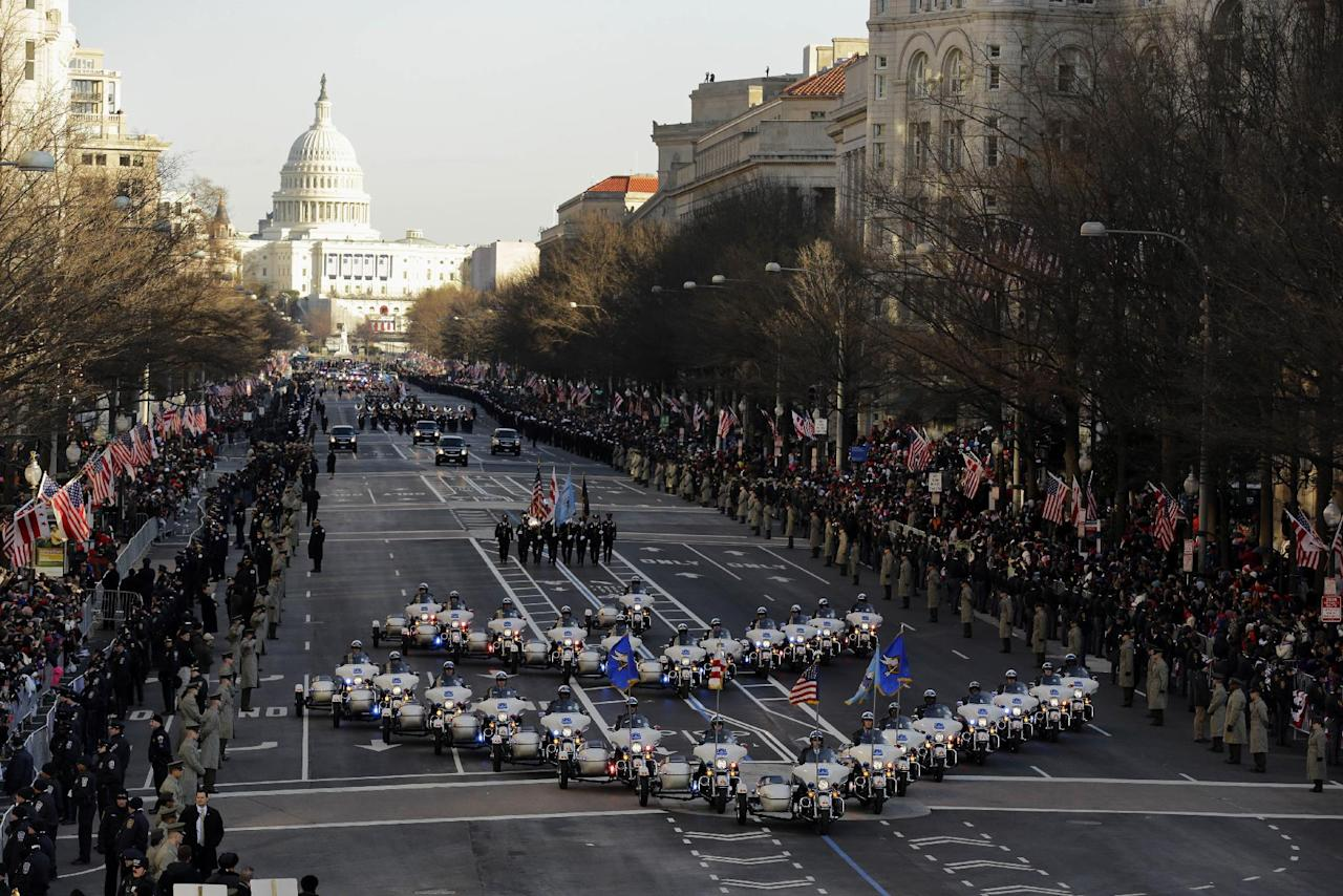 The 57th Presidential Inaugural Parade rolls down Pennsylvania Avenue from Capitol Hill in Washington, Monday,Jan. 21,2013, following President Barack Obama's ceremonial swearing-in ceremony during the 57th Presidential Inauguration. (AP Photo/Alex Brandon)
