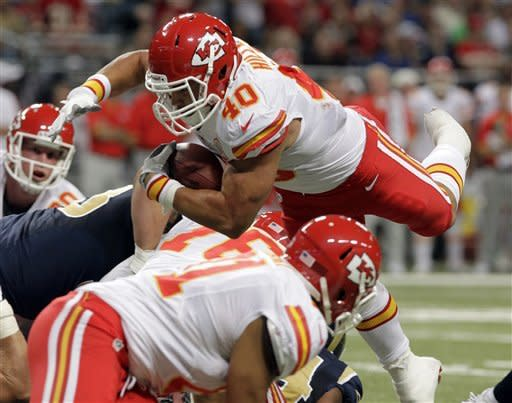Kansas City Chiefs running back Peyton Hillis, top, dives into the end zone for a one-yard touchdown run during the second quarter of a preseason NFL football game against the St. Louis Rams, Saturday, Aug. 18, 2012, in St. Louis. (AP Photo/Seth Perlman)