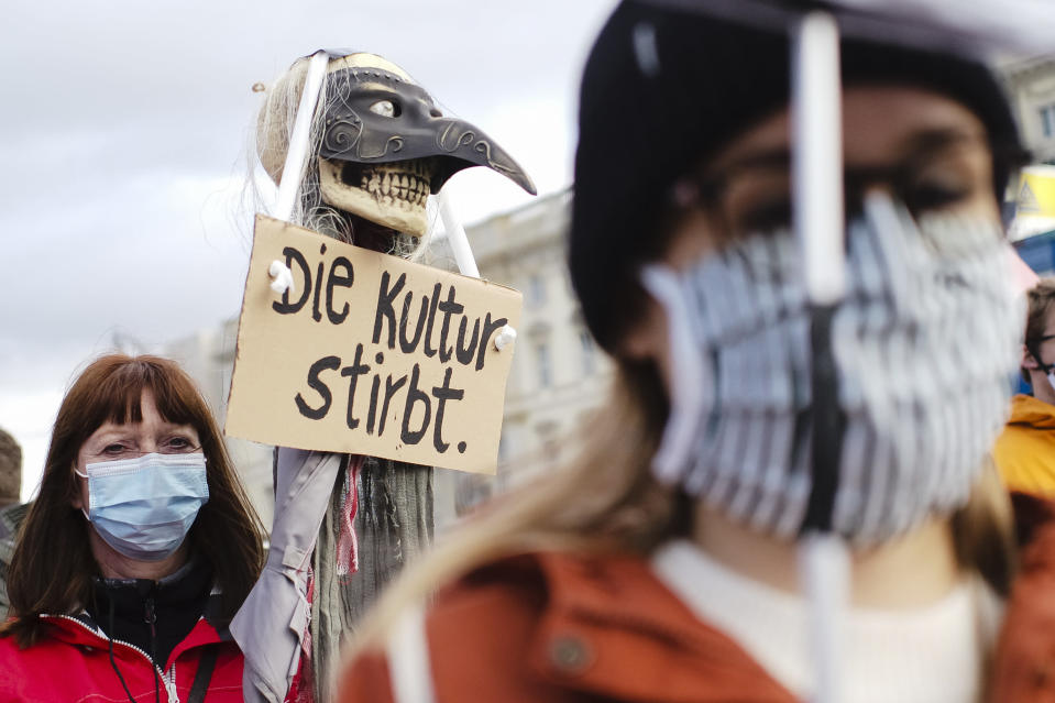 A woman holds a poster reading:'The culture dies' as she attends a protest of people working in the entertainment and event industry against the German government's economic policies to combat the spread of the coronavirus and COVID-19 disease and demand more support for their business, in Berlin, Germany, Wednesday, Oct. 28, 2020. (Photo/Markus Schreiber)