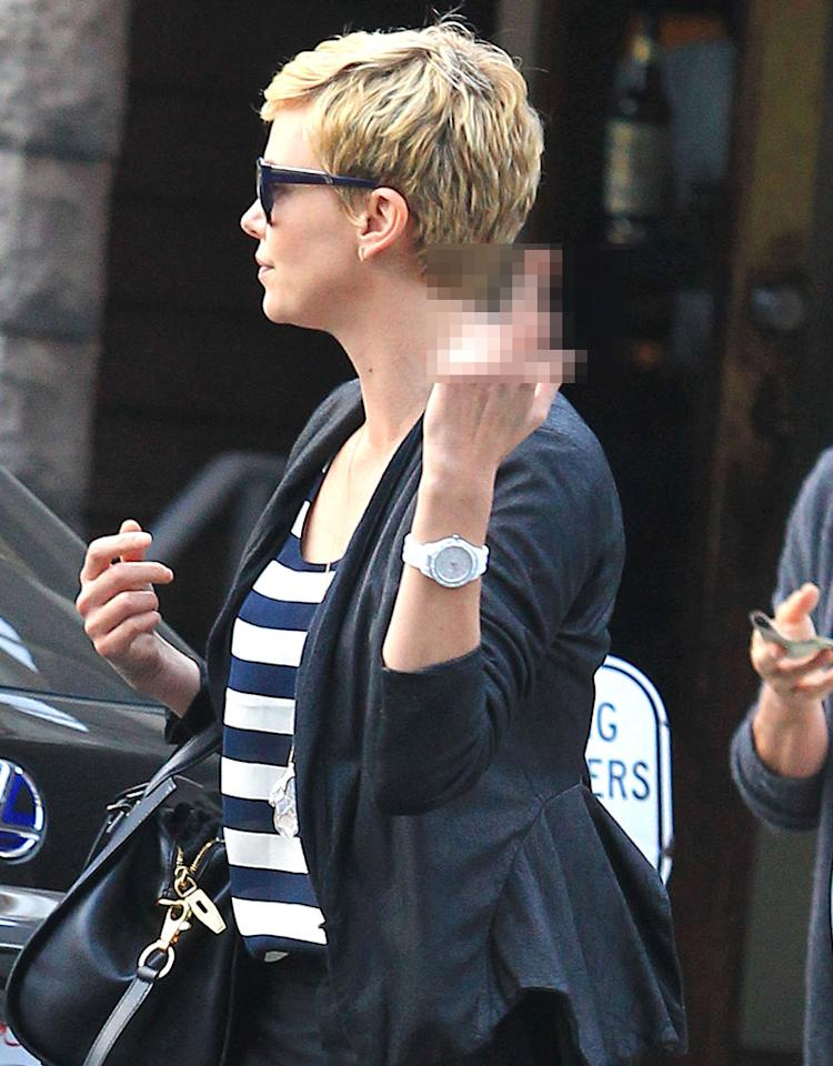 Actress Charlize Theron didn't hide her feelings towards a paparazzo as she headed to lunch in Los Angeles on Sunday. But that photographer ended up getting a pretty good shot after all ... (5/5/2013)