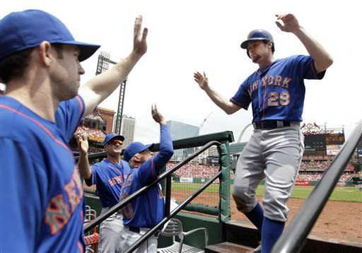 New York Mets' Daniel Murphy, right, is congratulated by Mike Baxter, left, bench coach Bob Geren and manager Terry Collins, second from right, after scoring during the third inning of a baseball game against the St. Louis Cardinals Thursday, May 16, 2013, in St. Louis. (AP Photo/Jeff Roberson)