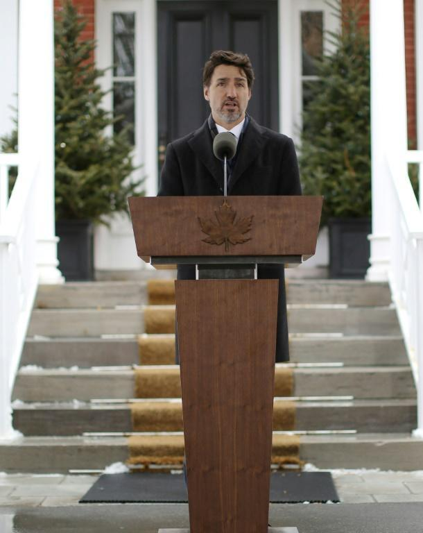 Canadian Prime Minister Justin Trudeau, speaking outside his home, is self-isolating with his family after his wife tested positive for the COVID-19 illness (AFP Photo/Dave Chan)