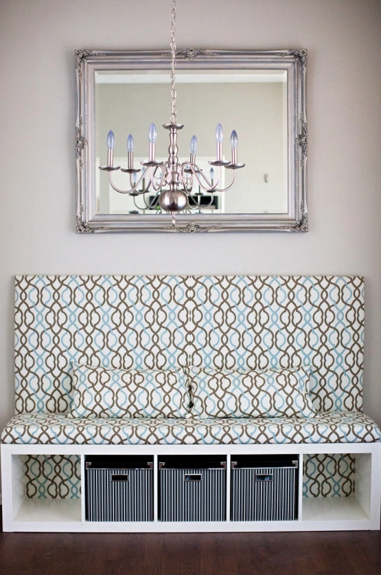 """<p>We all just want a convenient place to sit down and tie our shoes. Use one of IKEA's <a href=""""https://www.housebeautiful.com/home-remodeling/interior-designers/tips/g2064/bookshelf-decorating-ideas/"""" rel=""""nofollow noopener"""" target=""""_blank"""" data-ylk=""""slk:bookshelves"""" class=""""link rapid-noclick-resp"""">bookshelves</a> as the base of your bench so you also gain storage cubbies.</p><p>Get the tutorial at <a href=""""http://blog.krysmelo.com/2012/10/10/diy-banquette-seat-ikea-hack-dining-room-makeover/"""" rel=""""nofollow noopener"""" target=""""_blank"""" data-ylk=""""slk:Melodrama"""" class=""""link rapid-noclick-resp"""">Melodrama</a>.</p><p><a class=""""link rapid-noclick-resp"""" href=""""https://go.redirectingat.com?id=74968X1596630&url=https%3A%2F%2Fwww.ikea.com%2Fus%2Fen%2Fcatalog%2Fproducts%2F00275848%2F&sref=https%3A%2F%2Fwww.countryliving.com%2Fhome-maintenance%2Fg37186772%2Fentryway-ikea-hacks%2F"""" rel=""""nofollow noopener"""" target=""""_blank"""" data-ylk=""""slk:BUY NOW"""">BUY NOW</a> <em><strong>Shelf Unit, $50</strong></em></p>"""