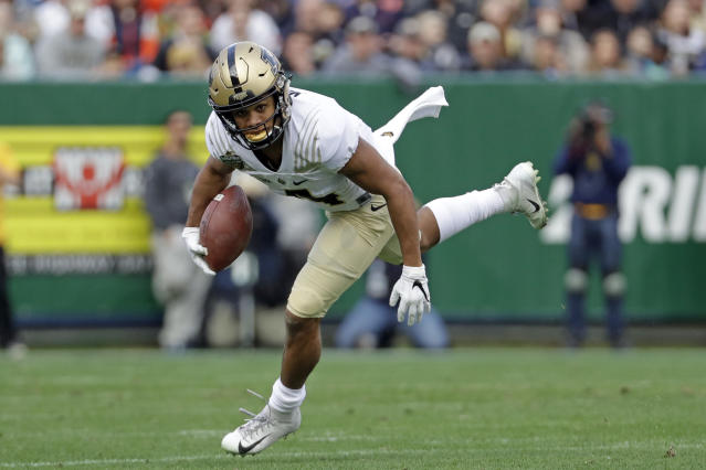 FILE - In this Friday, Dec. 28, 2018, file photo, Purdue wide receiver Rondale Moore carries the ball against Auburn in the first half of the Music City Bowl NCAA college football game, in Nashville, Tenn. Moore, who is being tabbed as a Heisman Trophy candidate after his breakout freshman season. (AP Photo/Mark Humphrey, File)