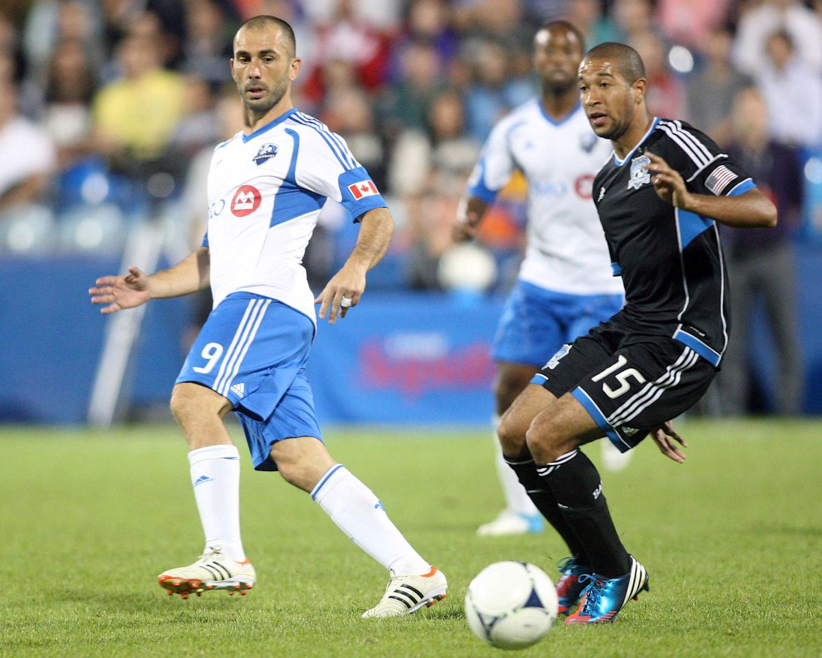 MONTREAL, CANADA - AUGUST 18:  Marco Di Vaio #9 of the Montreal Impact passes the ball in front of Justin Morrow #15 of the San Jose Earthquakes during the match at the Saputo Stadium on August 18, 2012 in Montreal, Quebec, Canada.  The Impact defeated the Earthquakes 3-1.  (Photo by Richard Wolowicz/Getty Images)